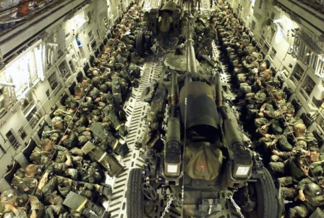Inside a C17 with two cannons. I was in an Airborne Artillery unit that actually dropped these 15,000lb cannons out of a plane with parachutes.